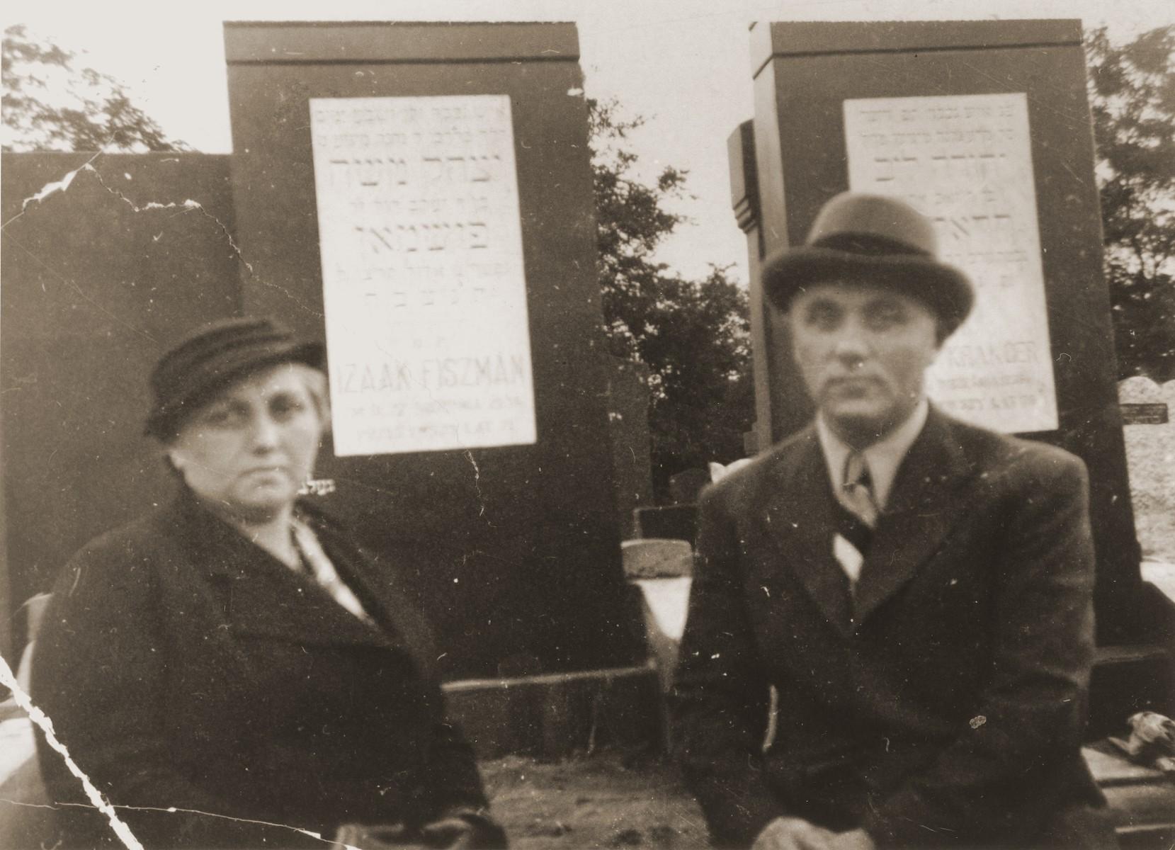 Karola Topor and Leon Fischmann visit the grave of their father, Isaak Fischmann, in Czestochowa.