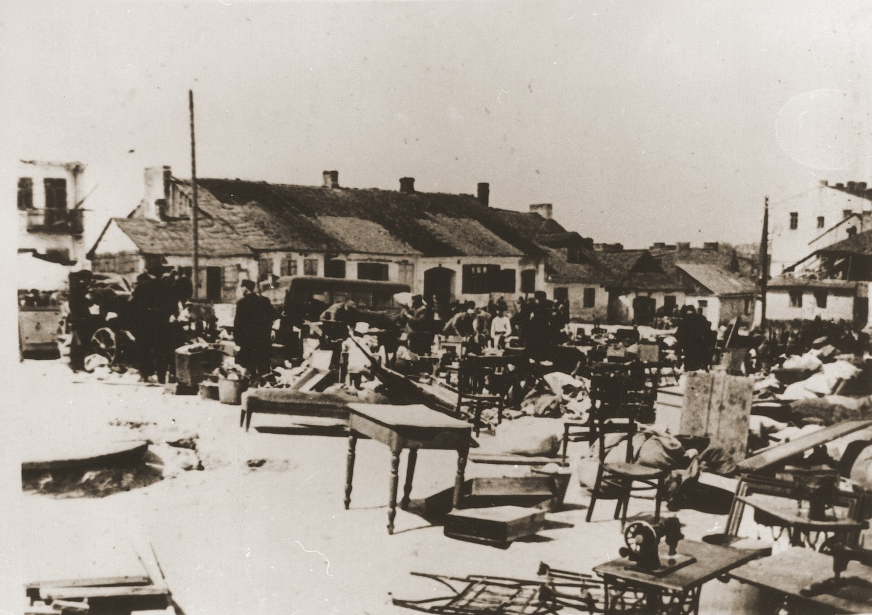 The furnishings of Jewish homes is collected and unloaded in a public square in the district of Wieniawa after the liquidation of the Lublin ghetto.