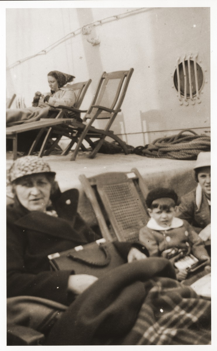 Jewish refugees sit on the deck of the SS Conte Verde while en route to Shanghai.  Pictured in the foreground, from left to right, are Selma Lewin, Ralf Harpuder, and Ursula Harpuder.