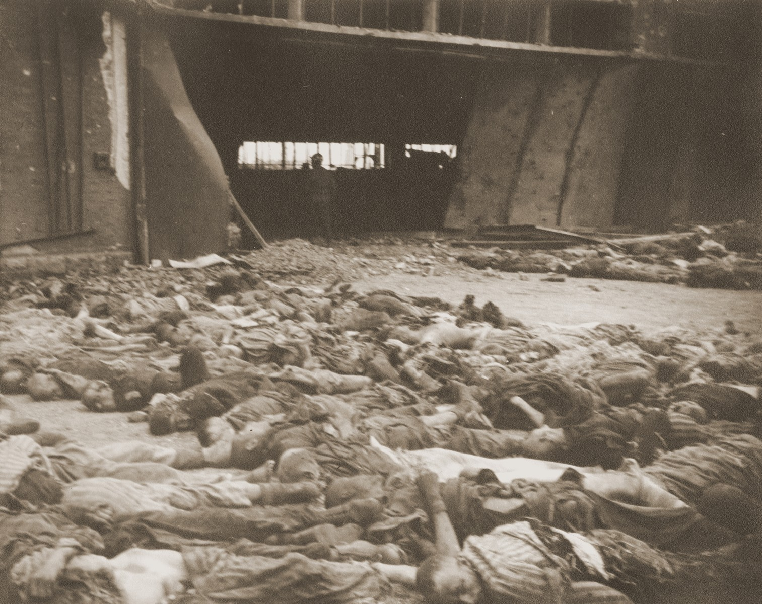 The bodies of prisoners killed in the Nordhausen concentration camp, which have been laid out in long rows outside the central barracks (Boelke Kaserne).