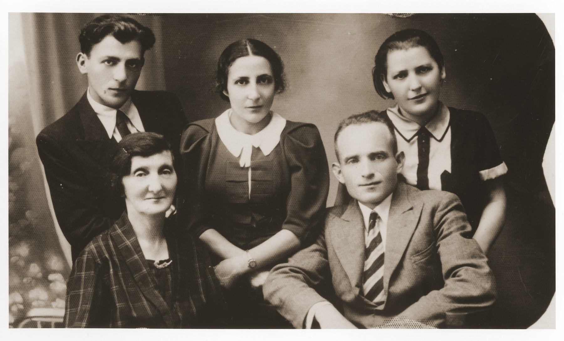 Studio portrait of members of the Zygielbojm family in Chelm.  Pictured in the back, from left to right, are: Reuven; Chana and Chava Zygielbojm.  Seated in front are: Henia Zygielbojm and Isaac Friedland, Chava's husband.