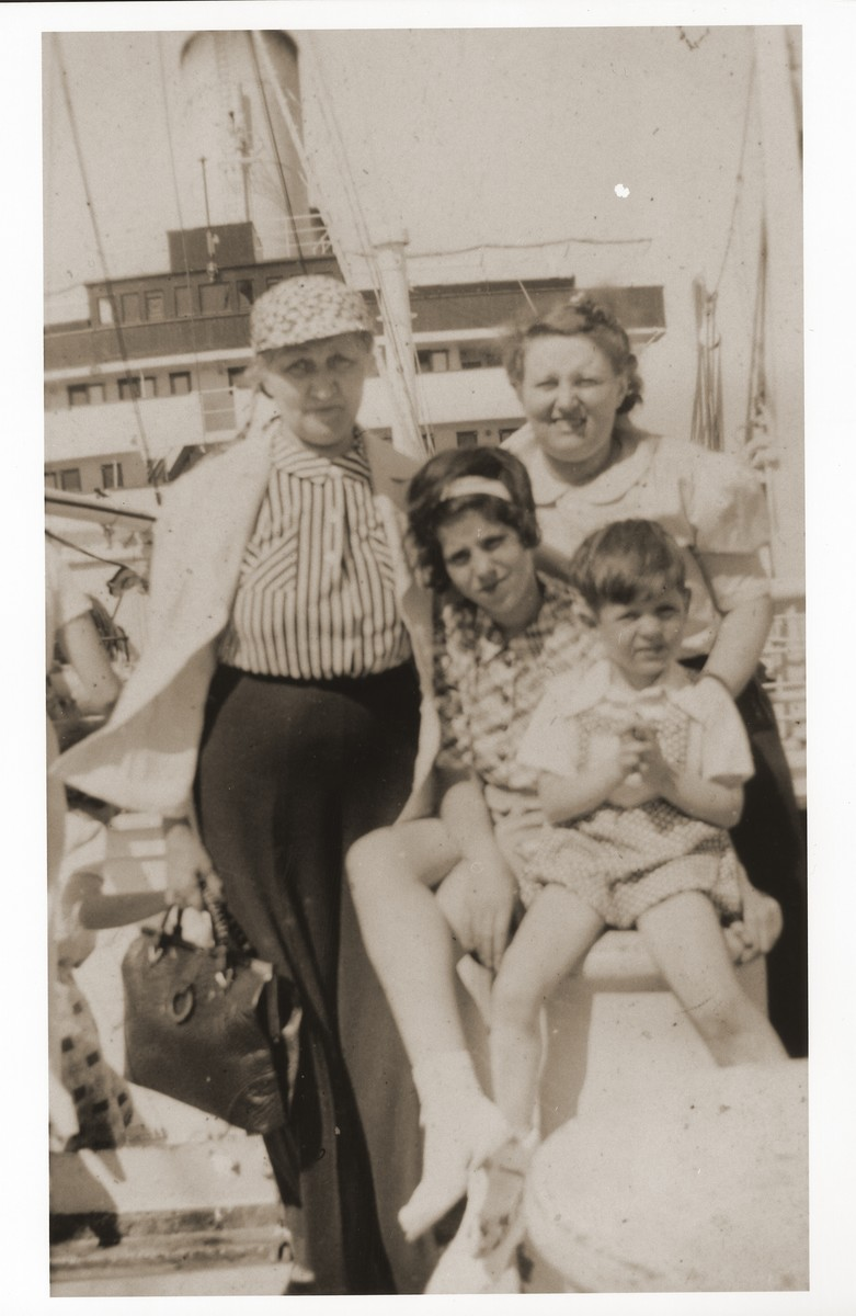 Jewish refugees en route to Shanghai aboard the SS Conte Verde.  Ralf Harpuder, the young boy, is pictured with his older sister, Ursula, his grandmother, Selma Lewin, and his mother, Gerda (right).