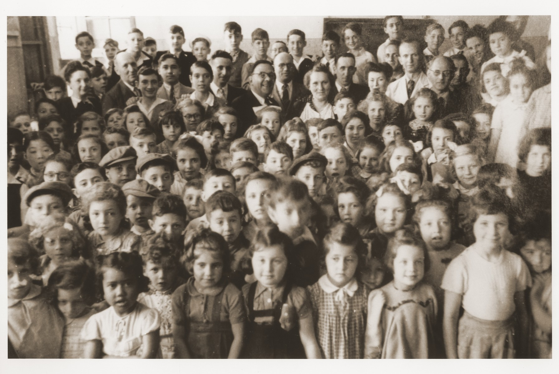 Group portrait of pupils and teachers at the Freysinger School for Jewish refugees in Shanghai.  Among those pictured is Rolf Eis, second row, third from the left.