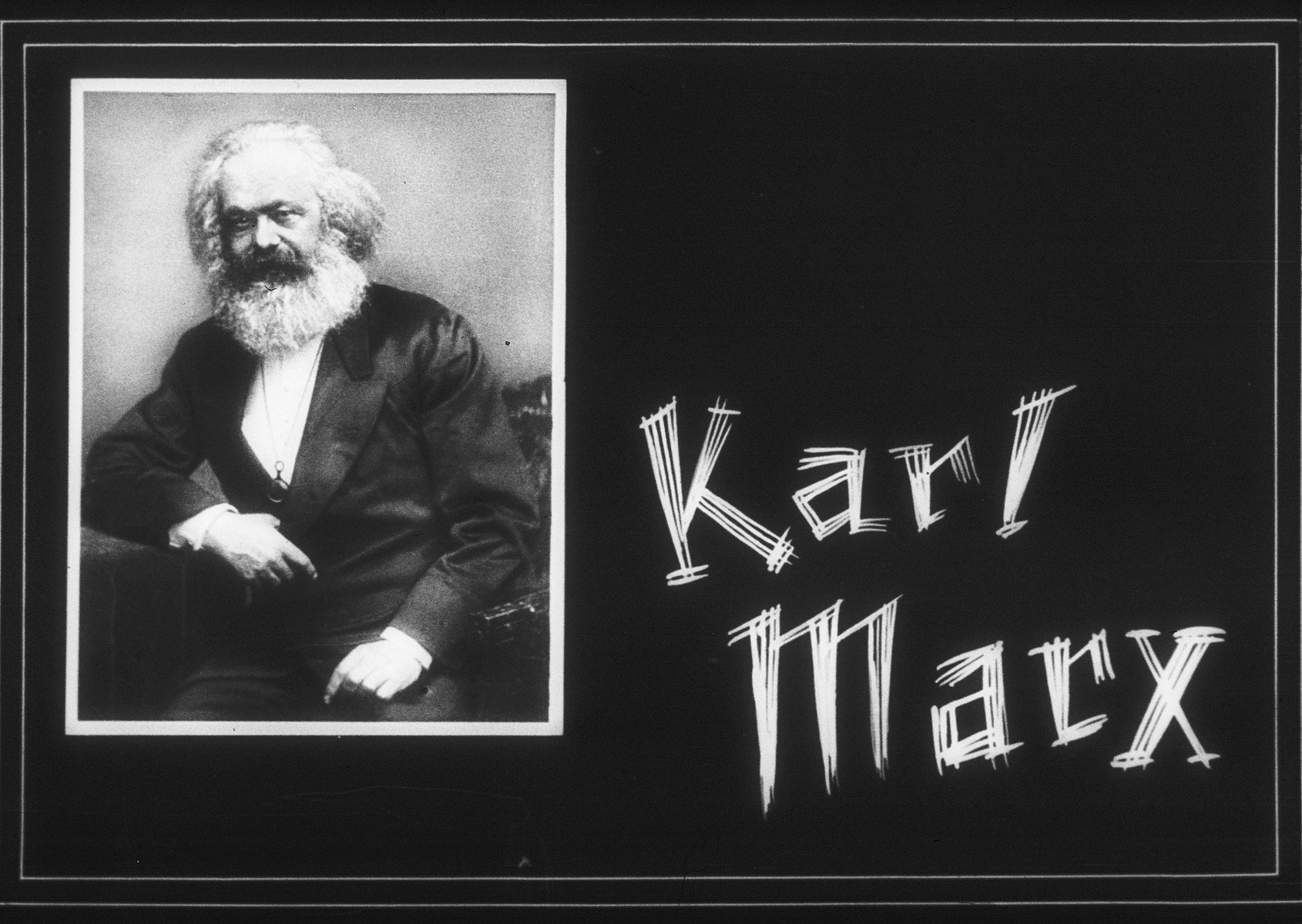 "Propaganda slide entitled, ""Karl Marx""."