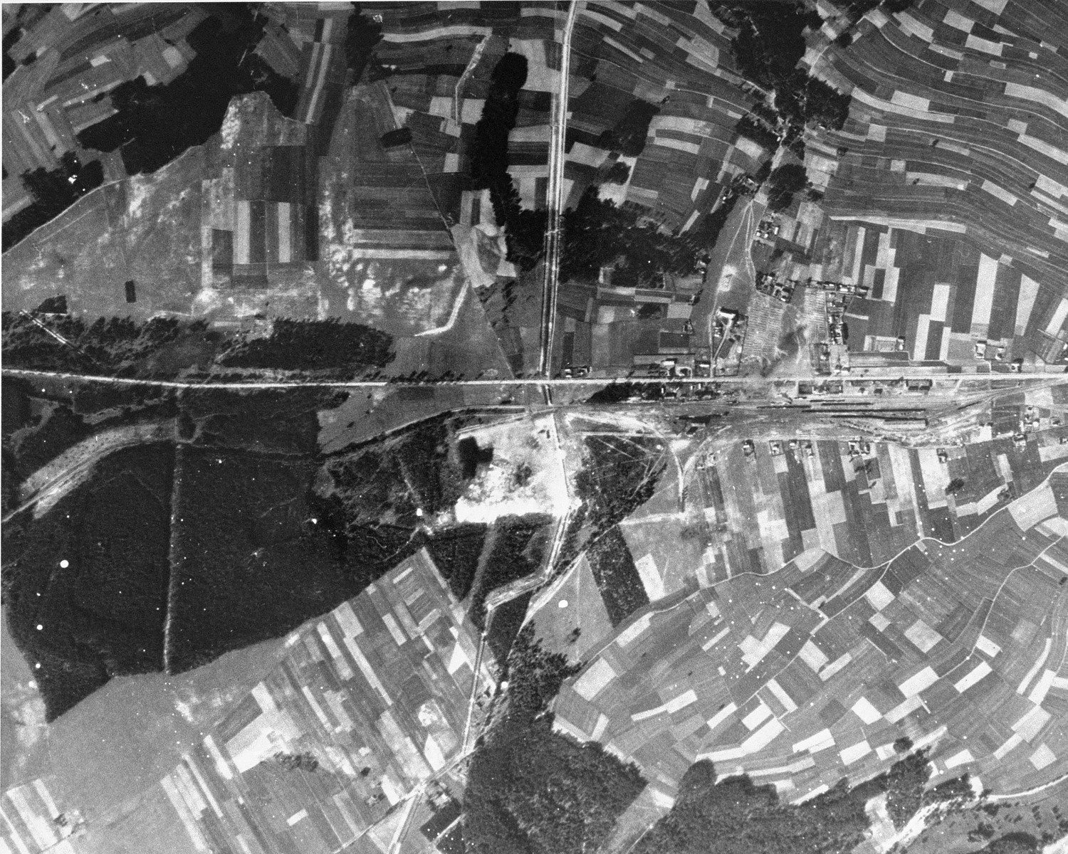 An aerial view of the Belzec area taken by the Luftwaffe during the war, which shows the camp and the rail lines leading to it.