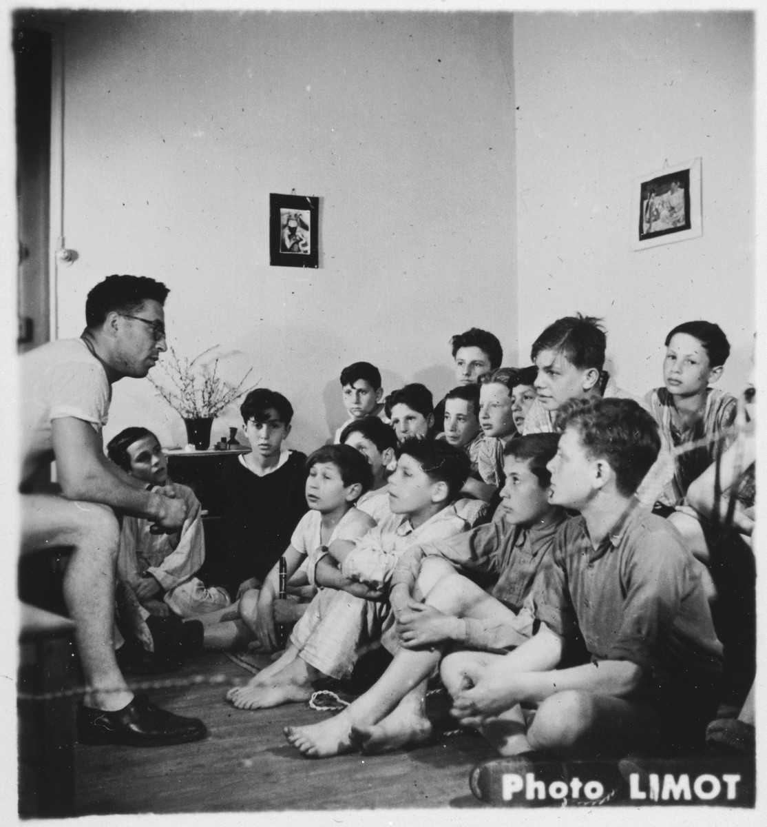 Boys in the Mehoncourt children's home meet with one of their counselors.  Albert Rigman is seated on the far right.