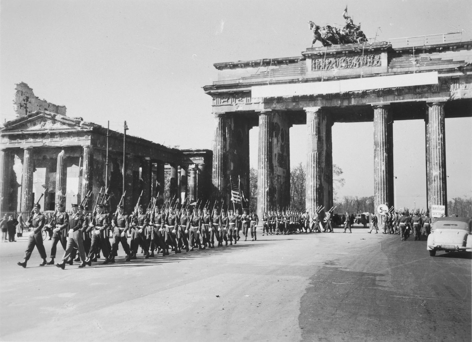 U.S. Army troops march through the Brandenburg Gate in Berlin.