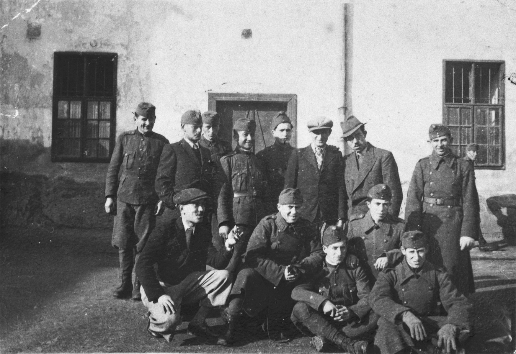Group portrait of former Jewish soldiers now conscripted into a Hungarian forced labor battalion.  Jeno Lebowiz is standing third from the right.