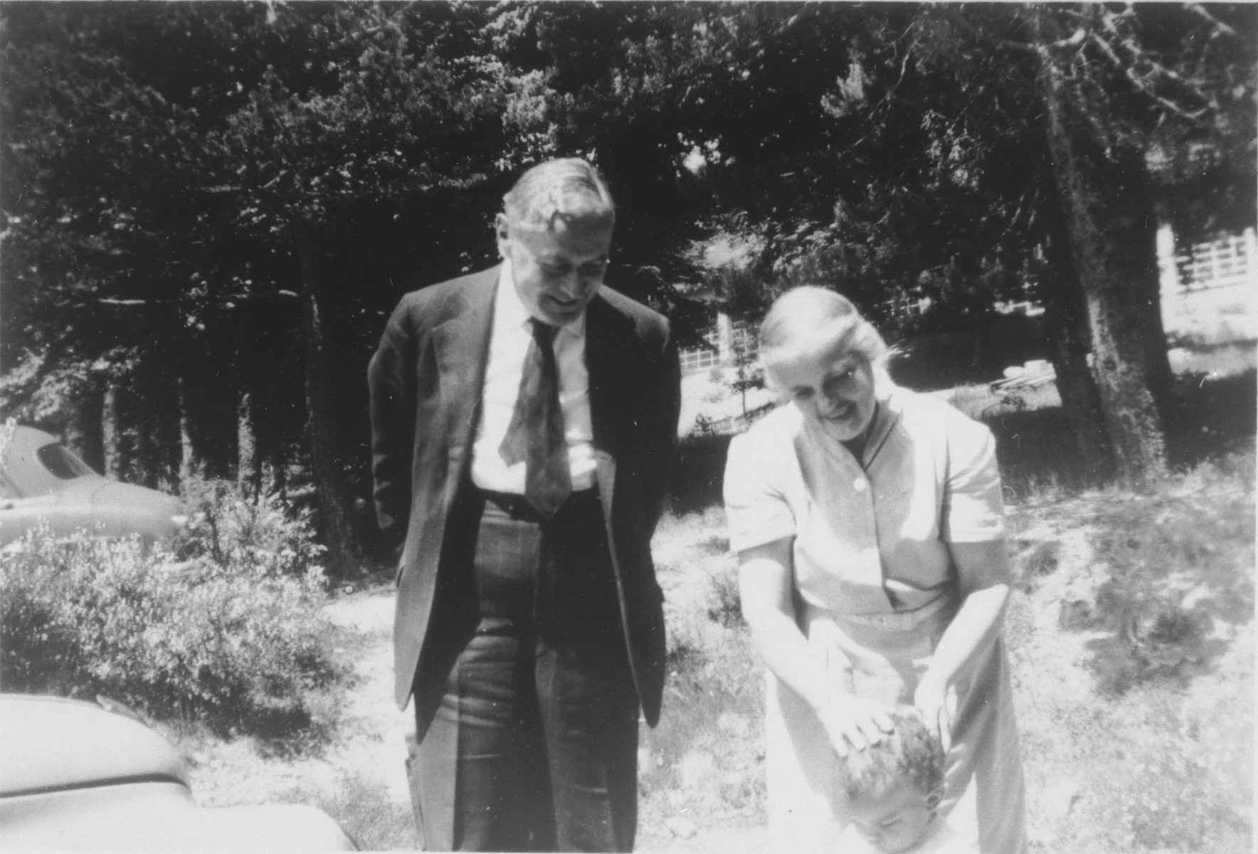 Pastor Edouard and Mildred Theis in the yard of their home.
