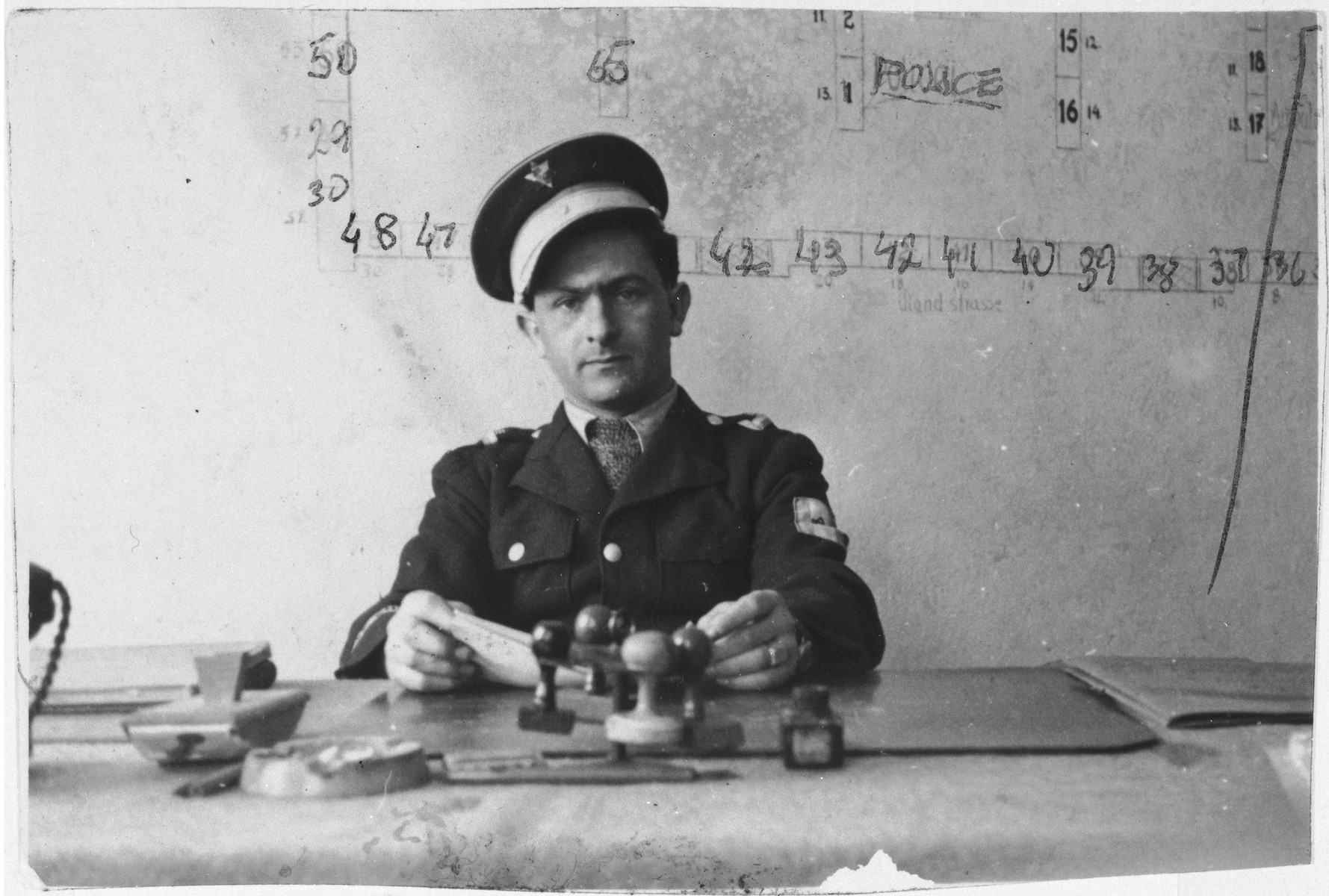 Police chief Willie Sterner sits at his desk in the Bindermichl displaced persons camp.
