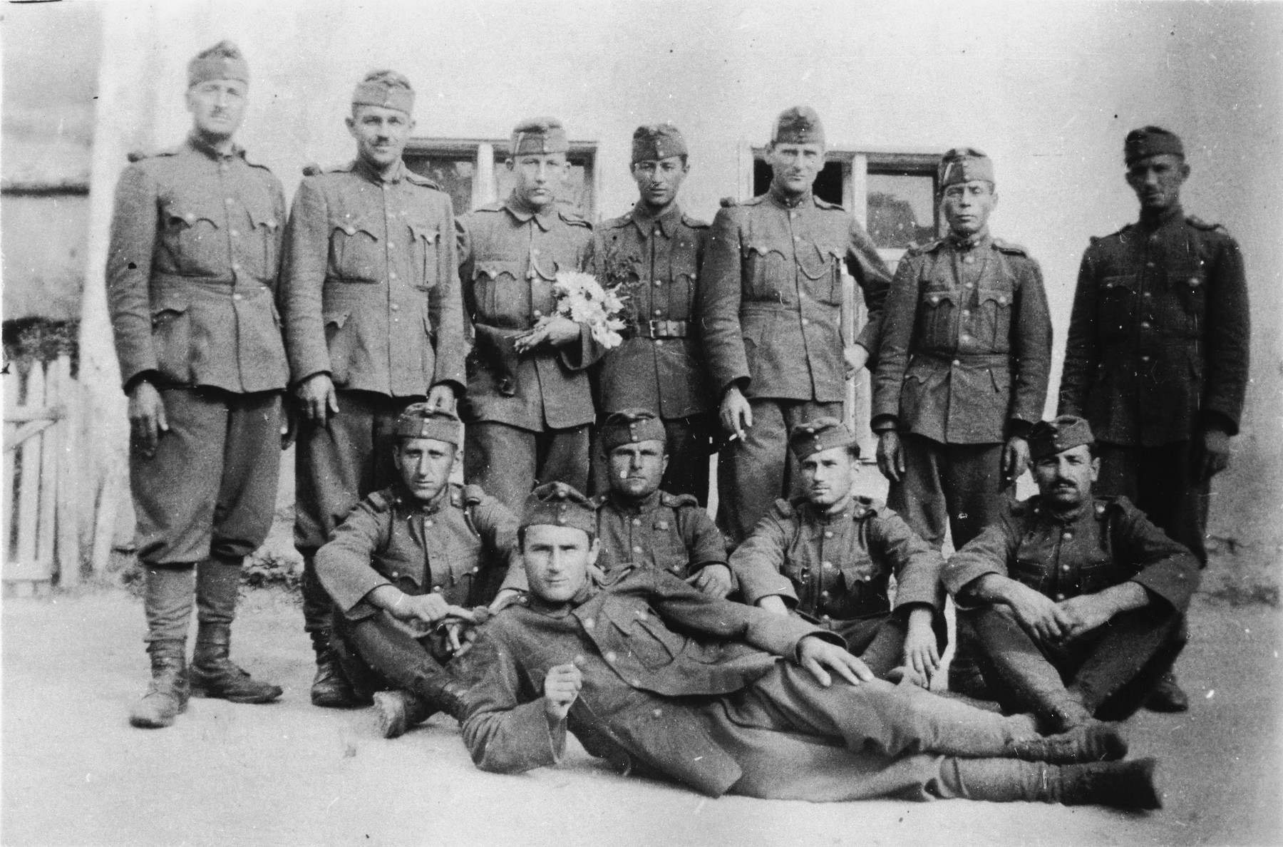 Group portrait of former Jewish soldiers now conscripted into a Hungarian forced labor battalion.  Jeno Lebowiz is standing in the center.