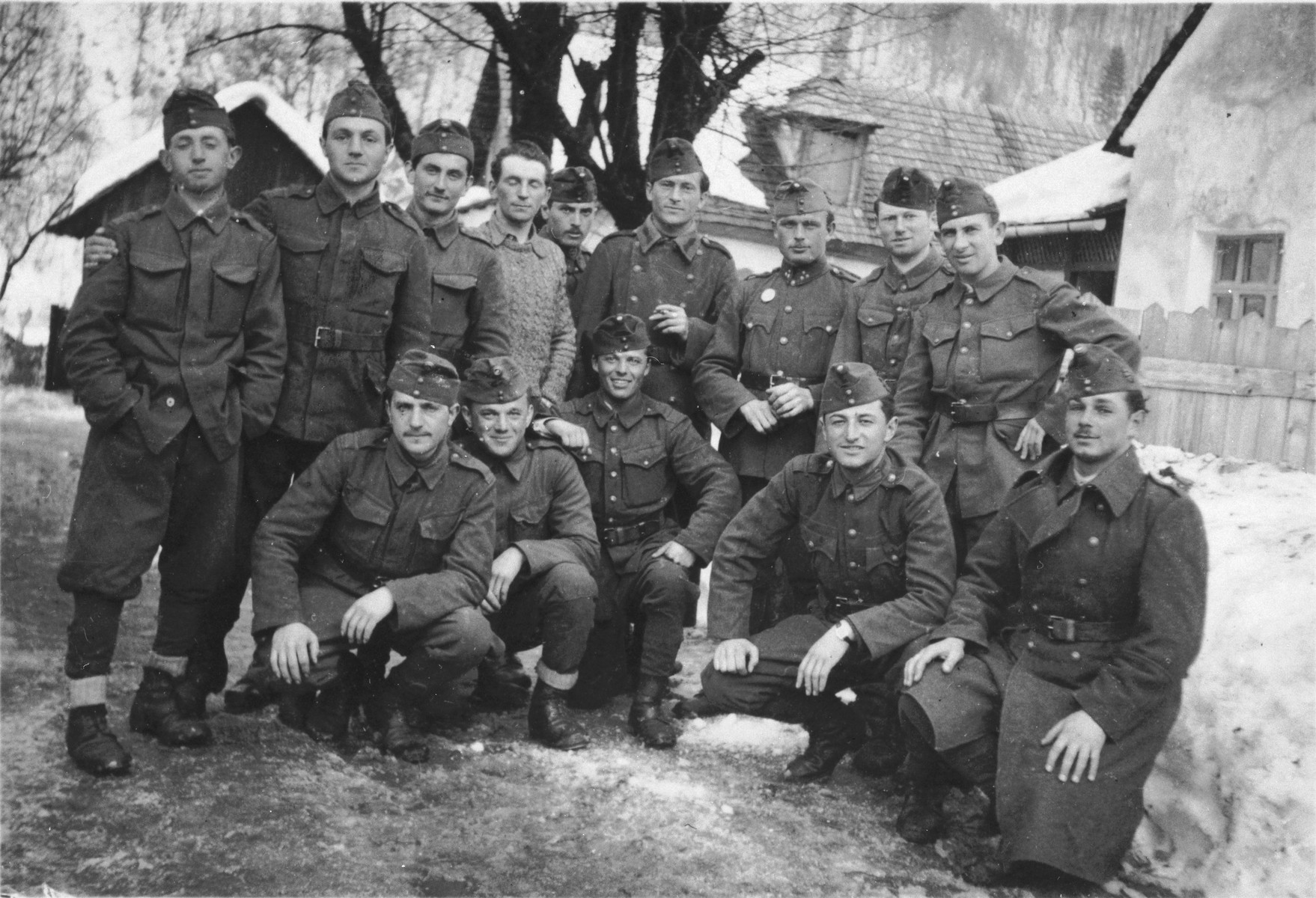 Group portrait of Jewish soldiers in the Hungarian army.  Jeno Lebowiz is pictured kneeling second from the right.  Also pictured are Klein (front row, center) and Greenstein (standing, second from the right).