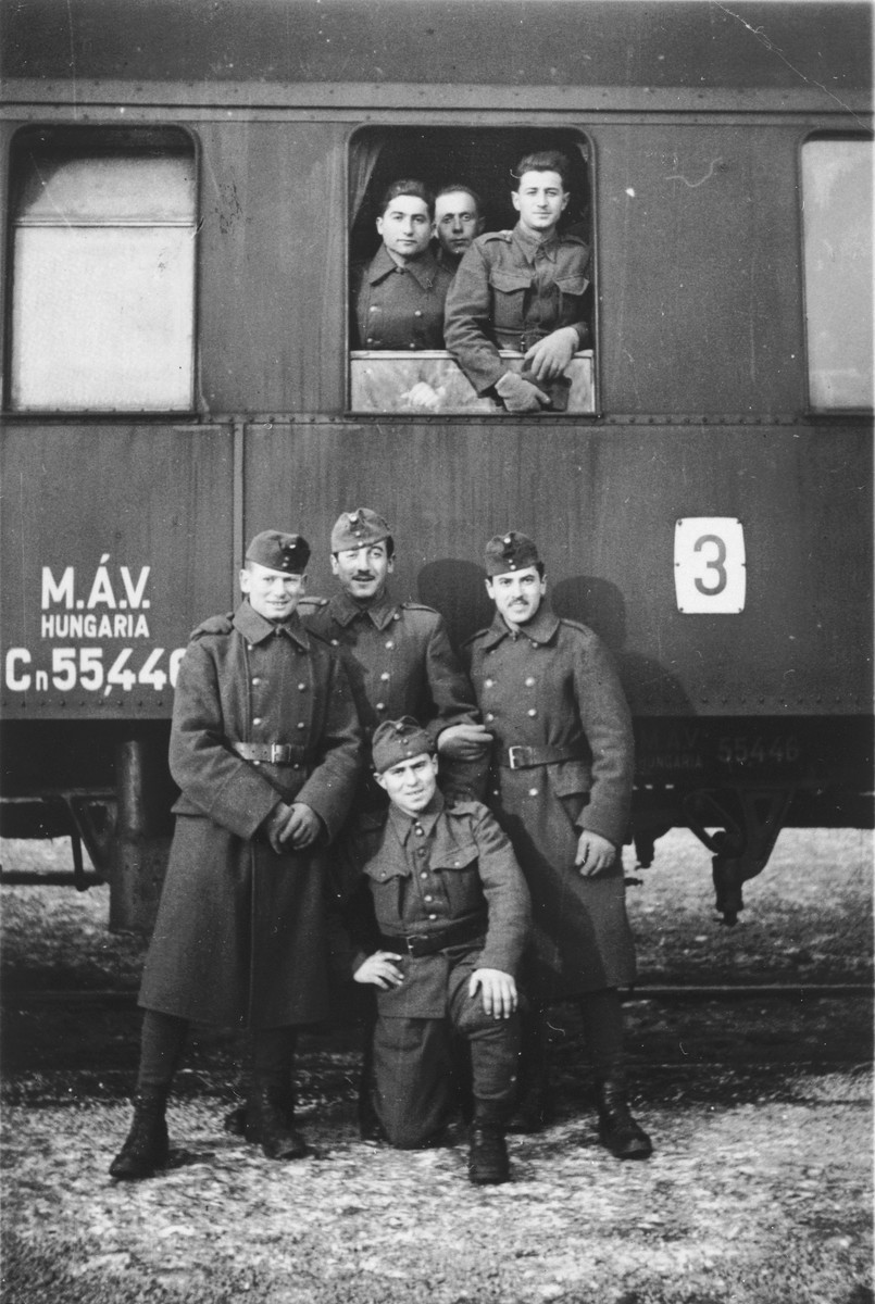 Group portrait of former Jewish soldiers on their way home after their demobilization.