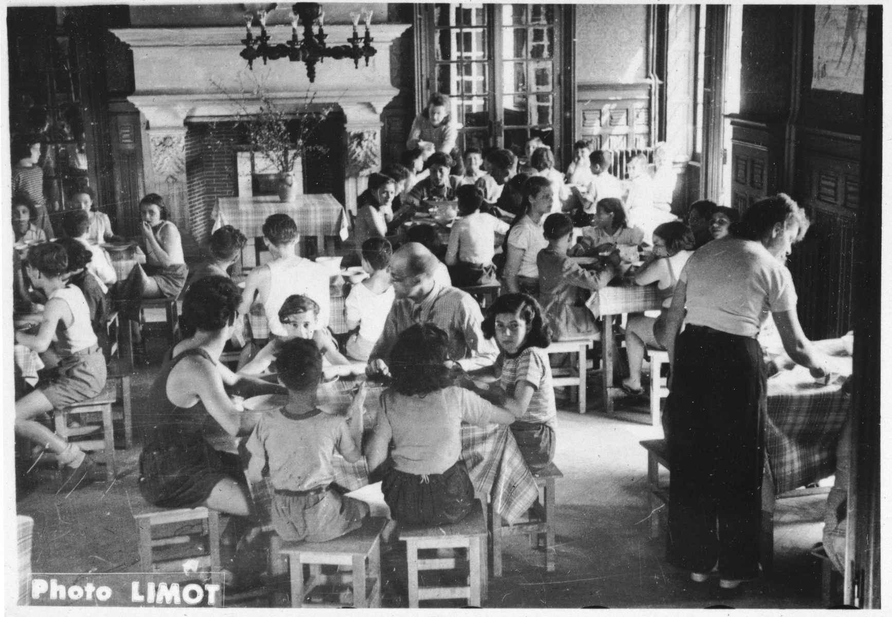 Children and counselors gather for a meal in the dining room of the Mehoncourt children's home.