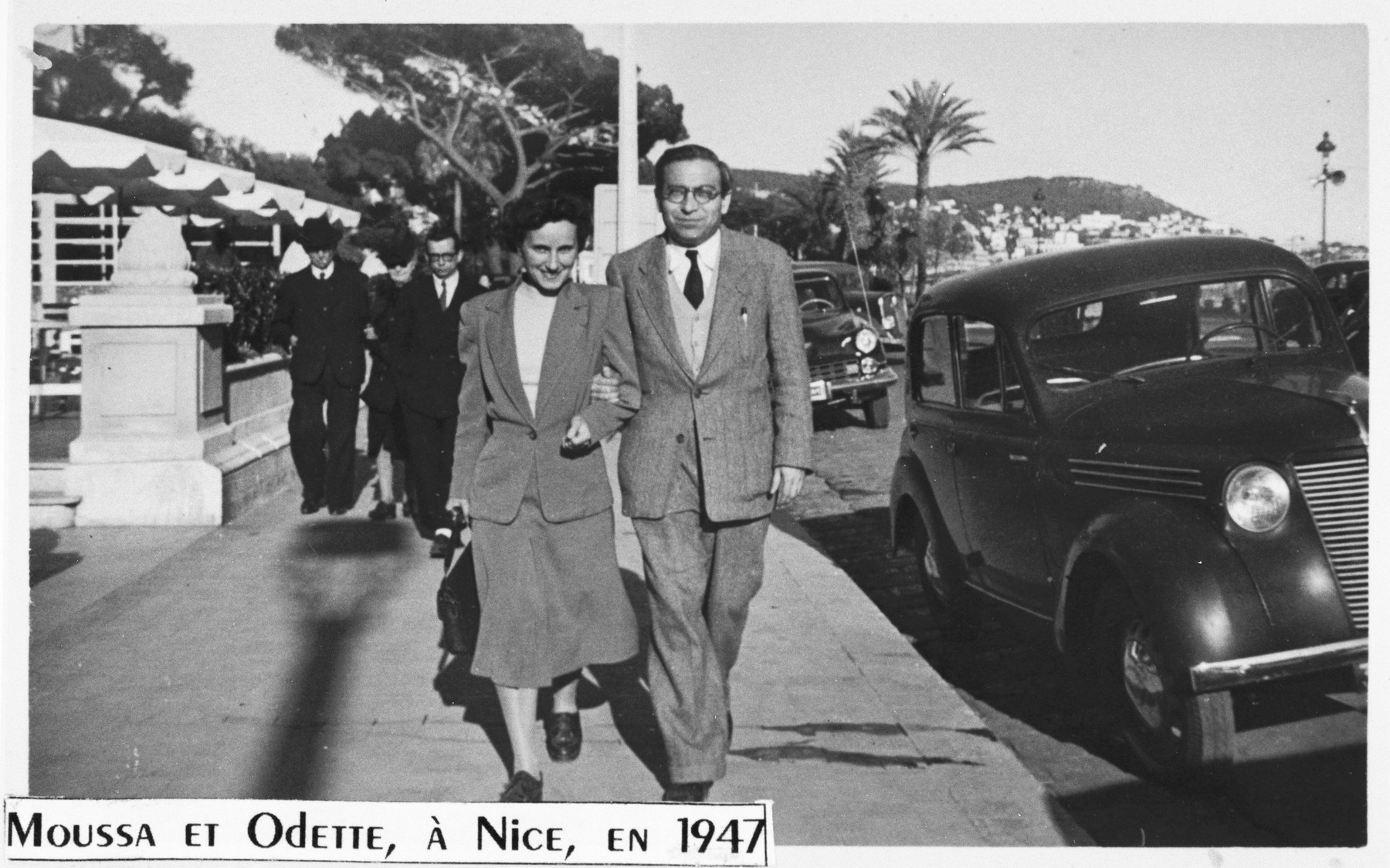 Jewish rescuers Moussa Abadi and Odette Rosenstock walk along a street in Nice after the war.