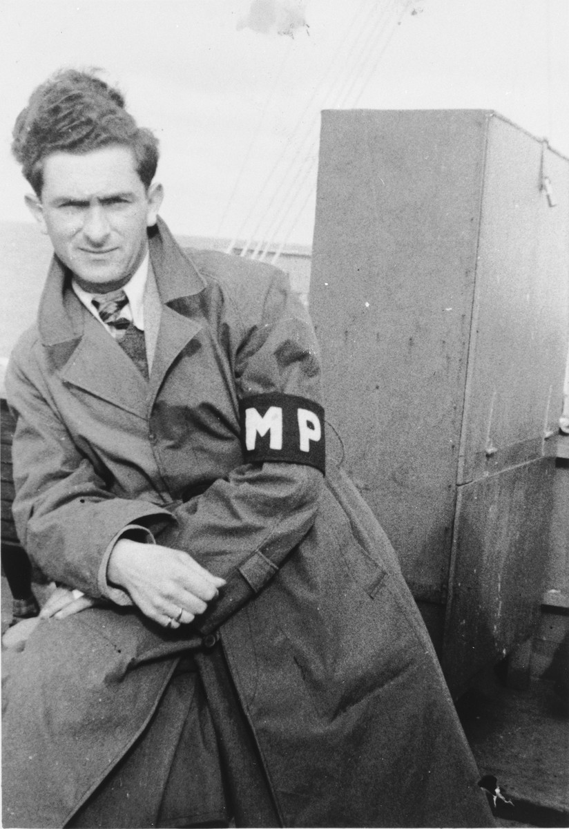 Willie Sterner wearing an MP armband poses on the deck of the SS Stewart while en route to Canada.