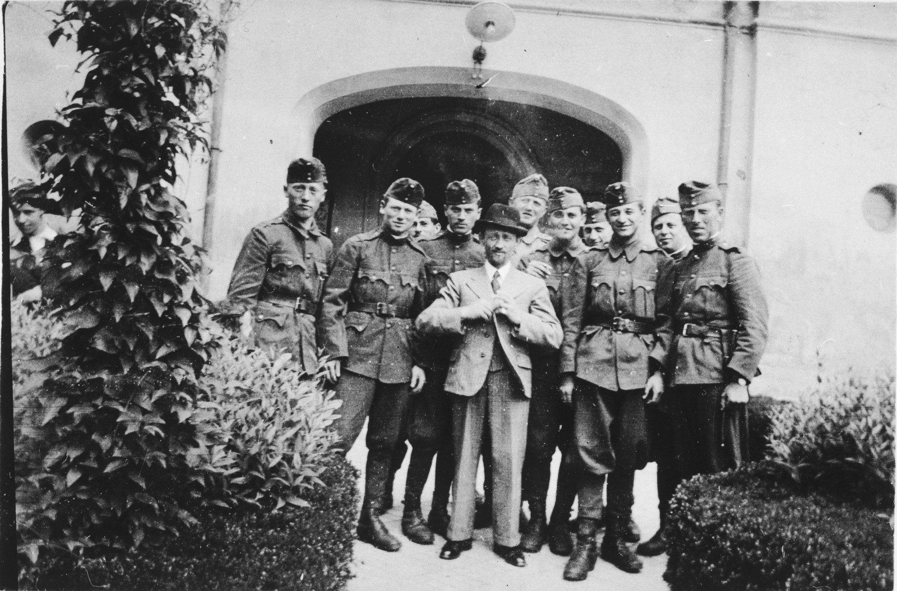 Former Jewish soldiers in a Hungarian forced labor battalion pose with the town's cantor outside the synagogue in Koszeg.  Jeno Lebowiz is fourth from the right.  Also pictured are Greenstein (second from the left), Hecht (fourth from the left) and Klein (fifth from the right).