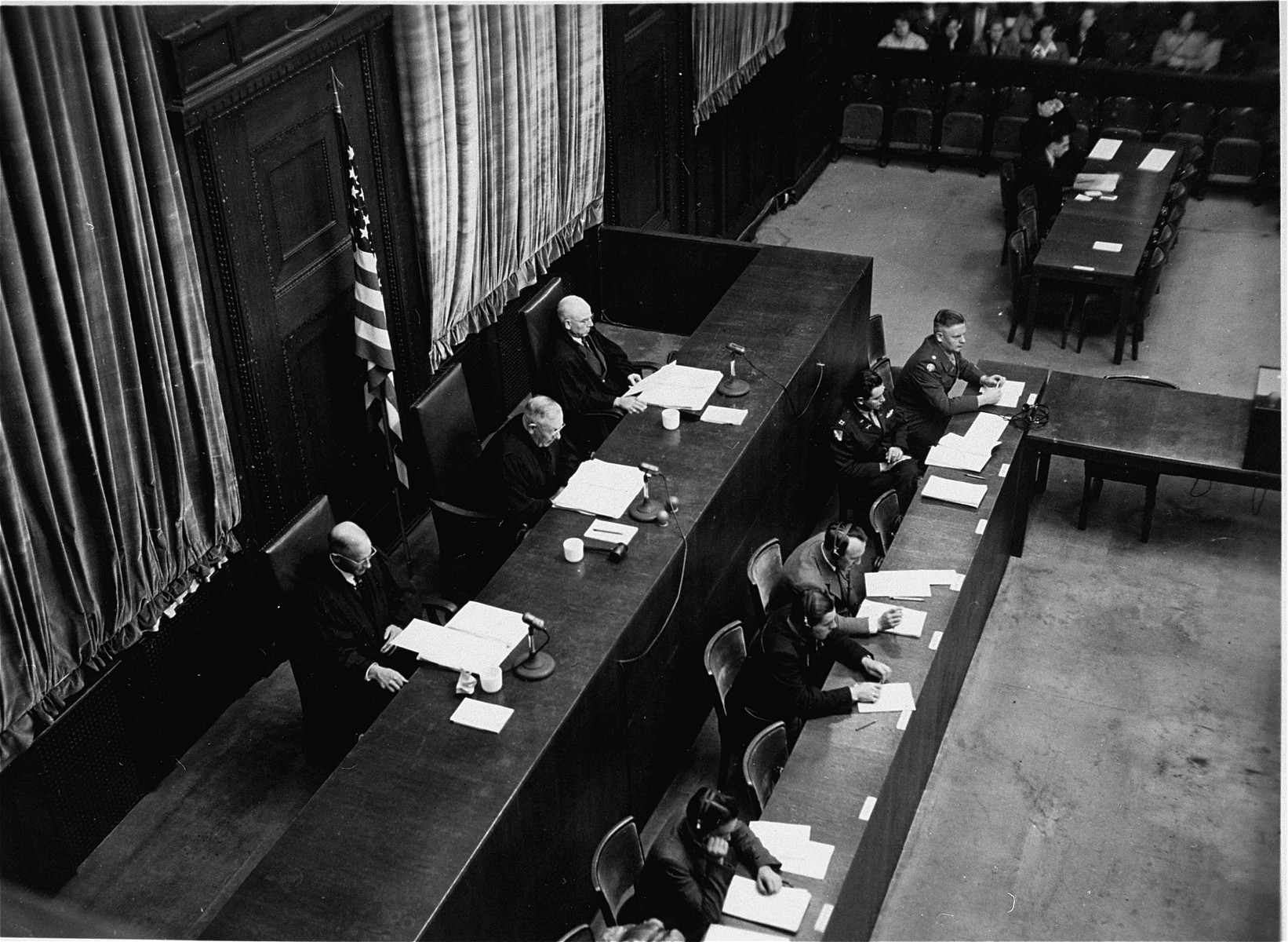 The members of the Tribunal listen to the proceedings of the High Command Case.    Seated from left to right are:  Winfield B. Hale, Presiding Justice John C. Young, and Justin W. Harding.