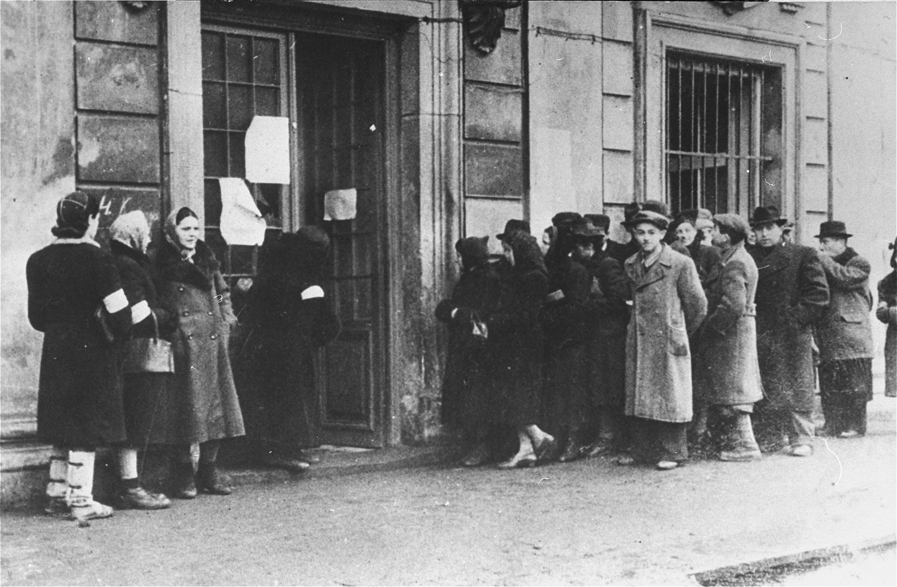Jews waiting in line outside the Judenrat to register for apartments in the ghetto.