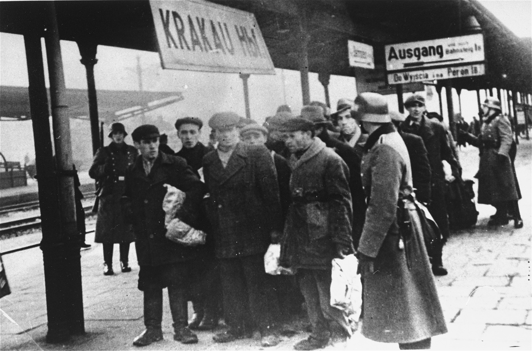Jews assembled for deportation wait on the platform in the railway station for further transport.
