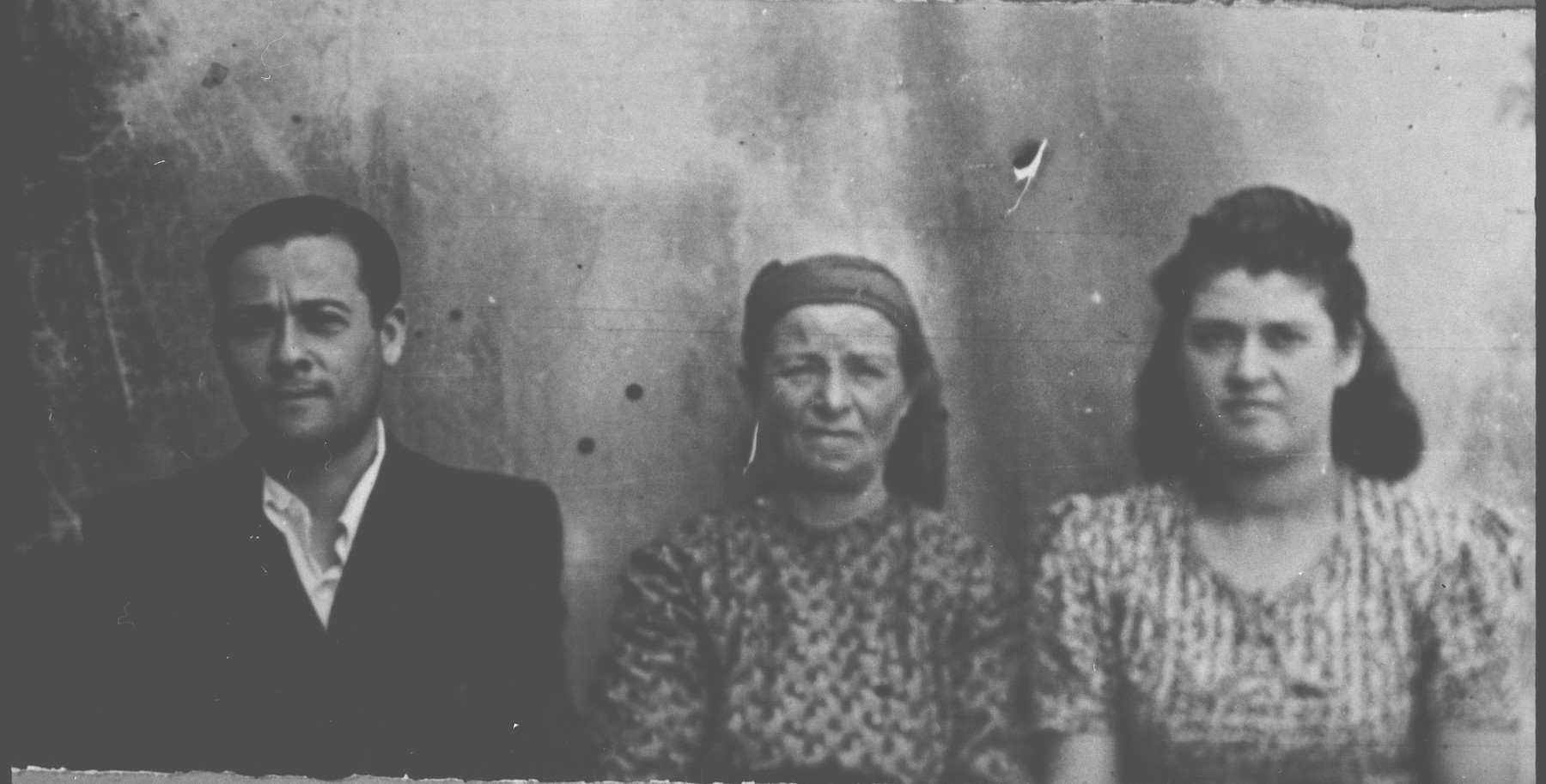 Portrait of Rekula Ischach (patronymic: Peris), Dario Ischach, son of Peris Ischach, and Sarika Ischach, daughter of Peris Ischach.  Dario was a tailor and Sarika, a student.  They lived at Karagoryeva 68 in Bitola.