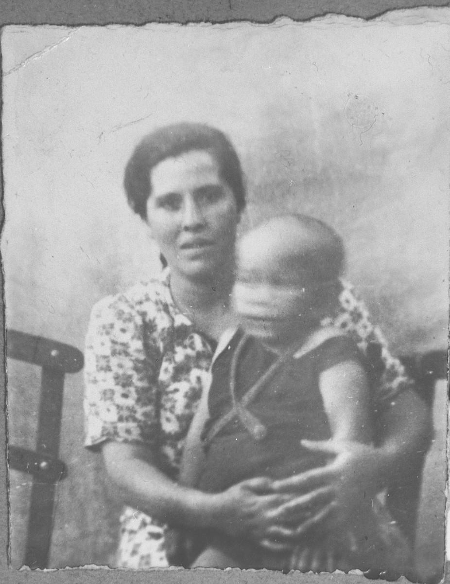 Portrait of Luna Ischach, wife of Avram Ischach, with baby.  She lived at Bistritska 9 in Bitola.