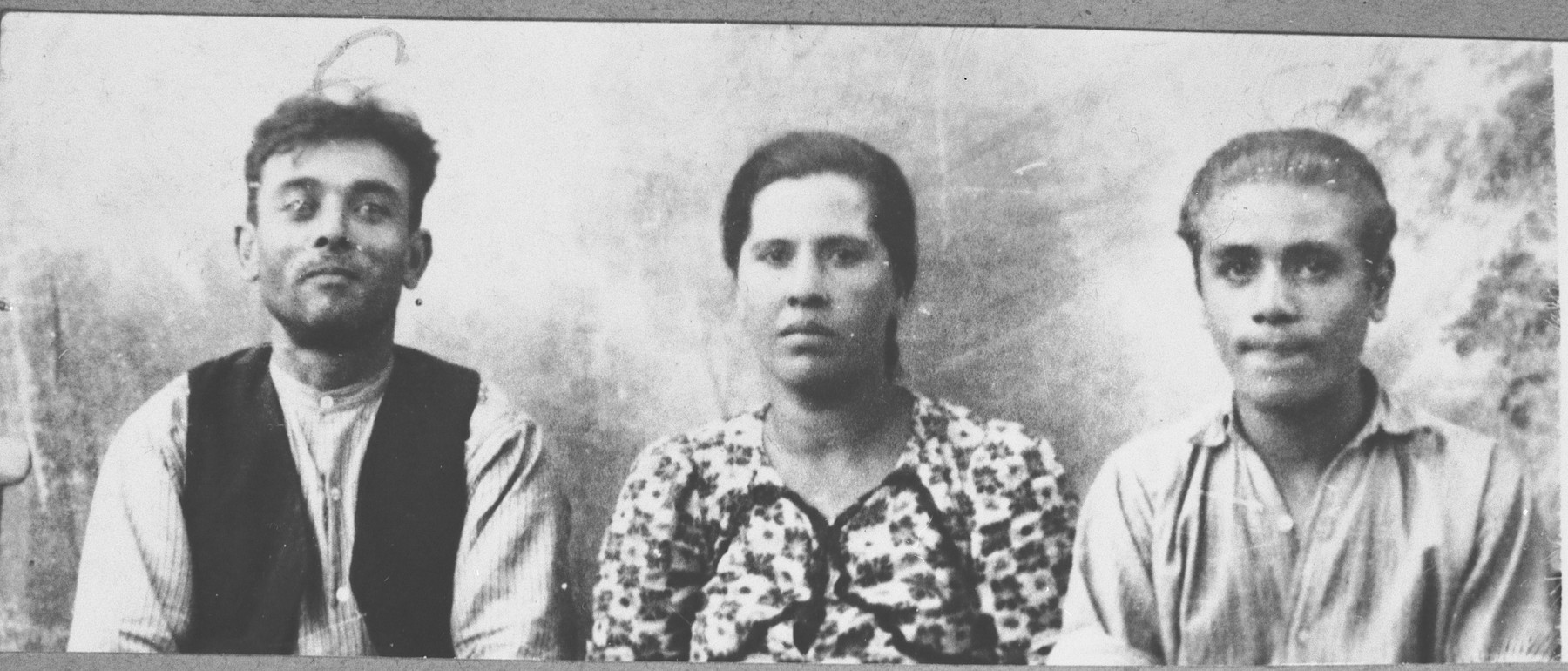 Portrait of Avram Ischach, son of Peris Ischach, Avram's wife Luna, and his son, Peris.  Avram was a greengrocer.  Peris was a student.  They lived at Bistritska 9 in Bitola.