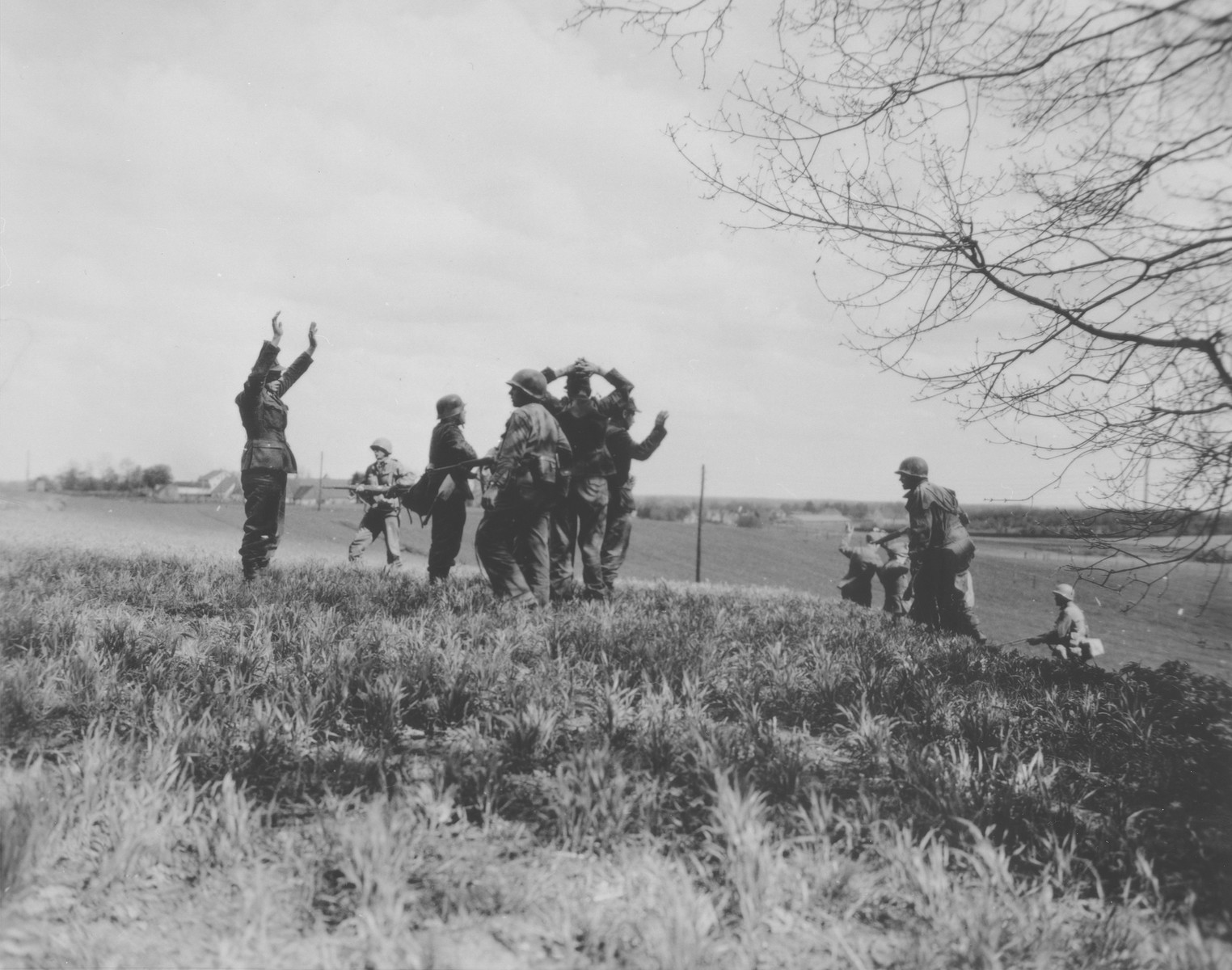 American soldiers of the 42nd Rainbow division capture fleeing SS men near Dachau.
