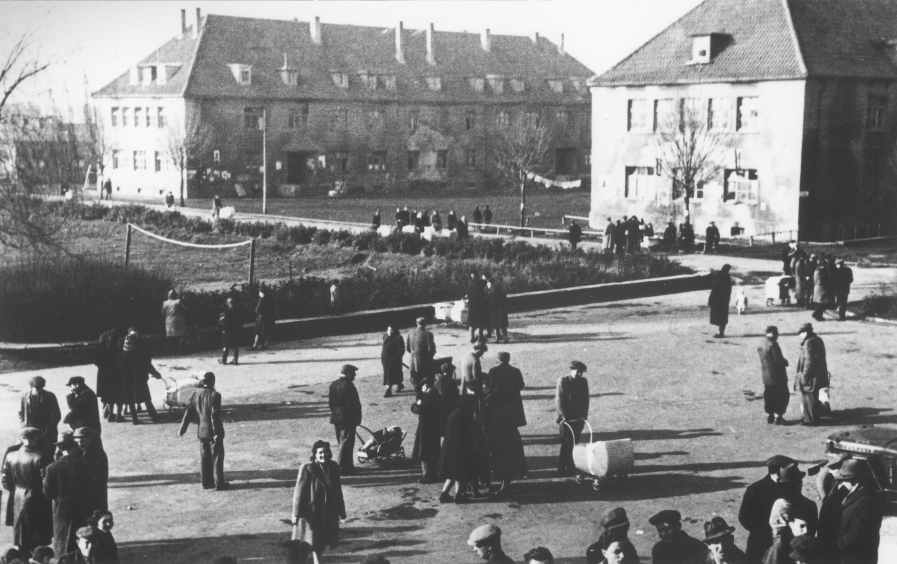 Jewish DPs gather in a central square of the Eschwege displaced persons camp following a raid by American military police searching for contraband.