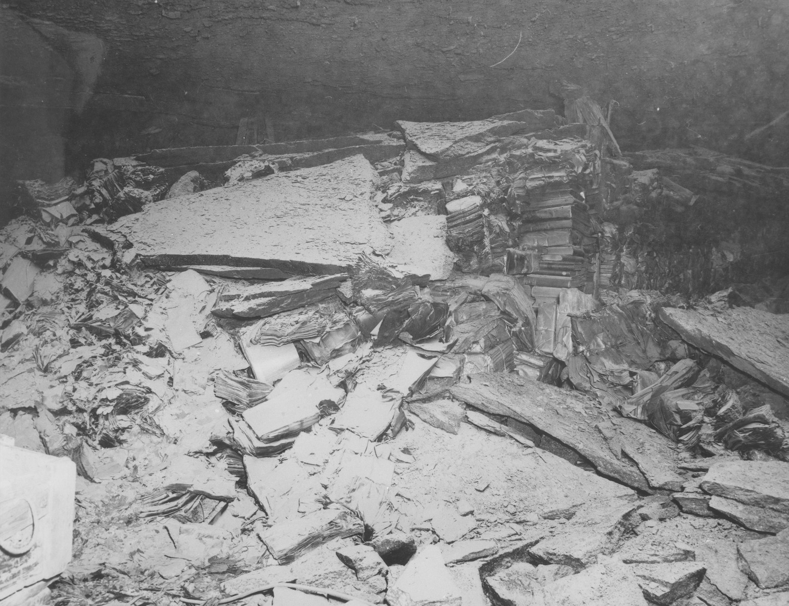 View of the charred remains of books from libraries in Berlin and Marburg that had been stored in a salt mine near Heimboldshausen, Germany.    According to American military sources, the books were burned in the salt mines by displaced persons.