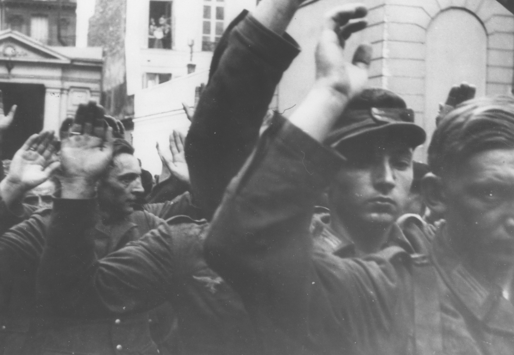Captured German troops are marched through the streets during the liberation of Amsterdam.