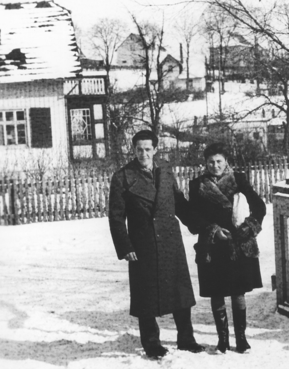 Esther Kac and Leon Lewinstein pose outside in the snow at the Gold Cup displaced persons camp shortly before their marriage.