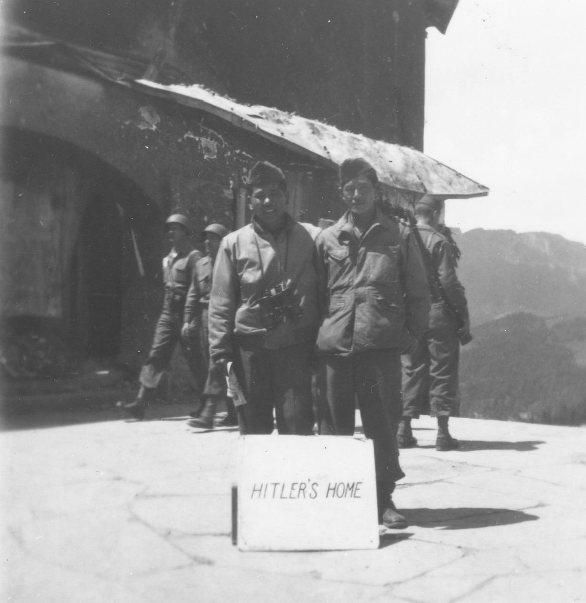 Royce Higa (left) and Hideo Nakamine (right), Japanese-American soldiers with the 522nd Field Artillery battalion, pose outside the destroyed Berghof, Hitler's mountain retreat in the Bavarian Alps.
