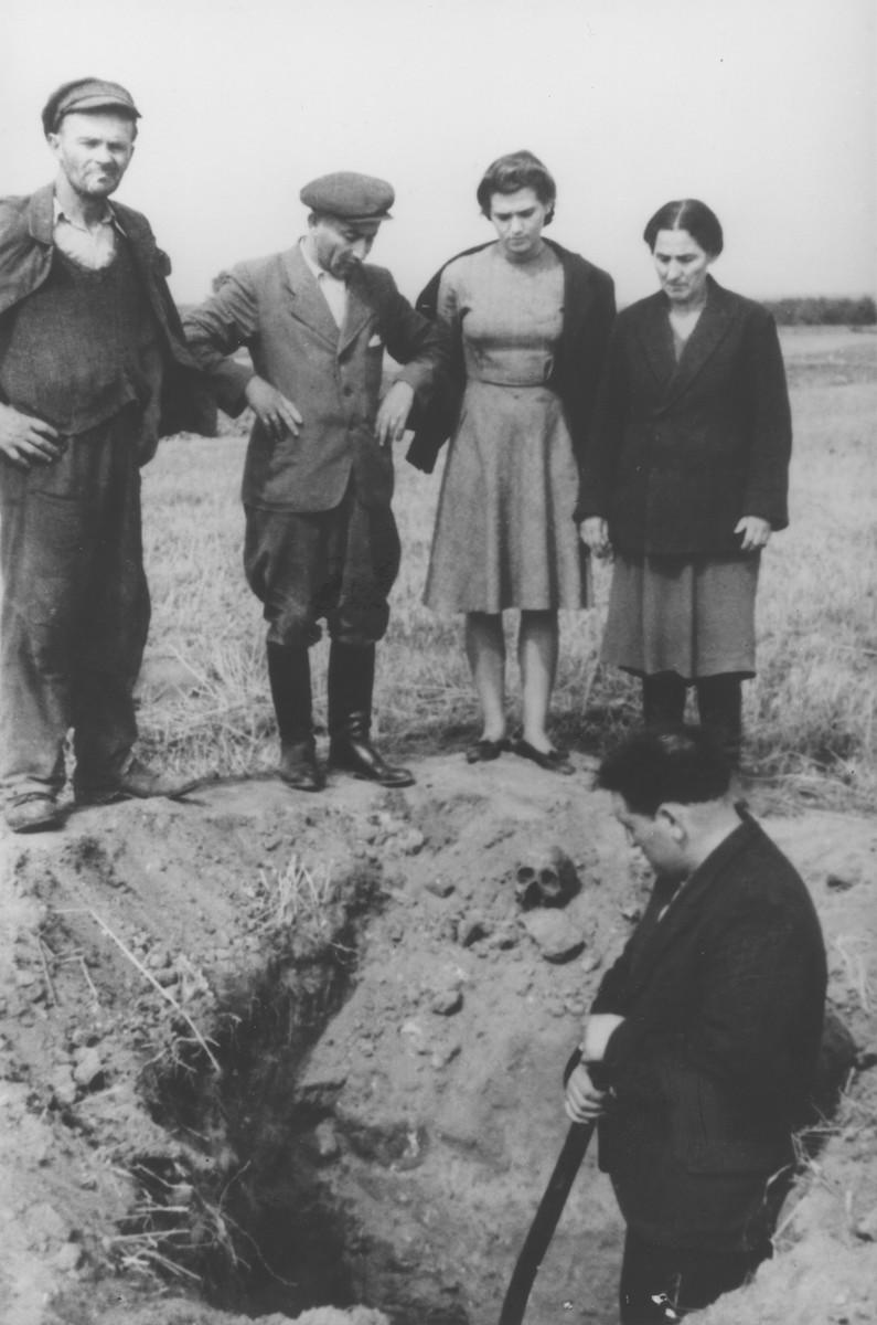 Jewish survivors watch as Poles exhume a mass grave in Sokolow Podlaski.