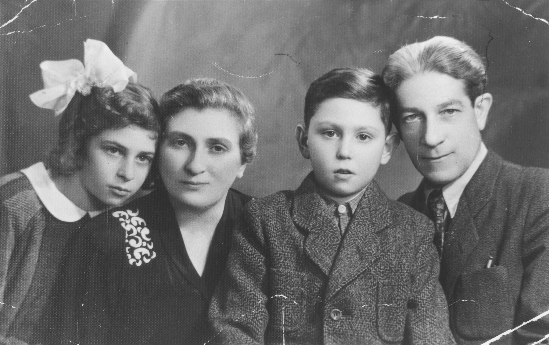 Yona Kunstler (left) poses with her parents and cousin, Gaby, shortly after they were reunited after World War II.