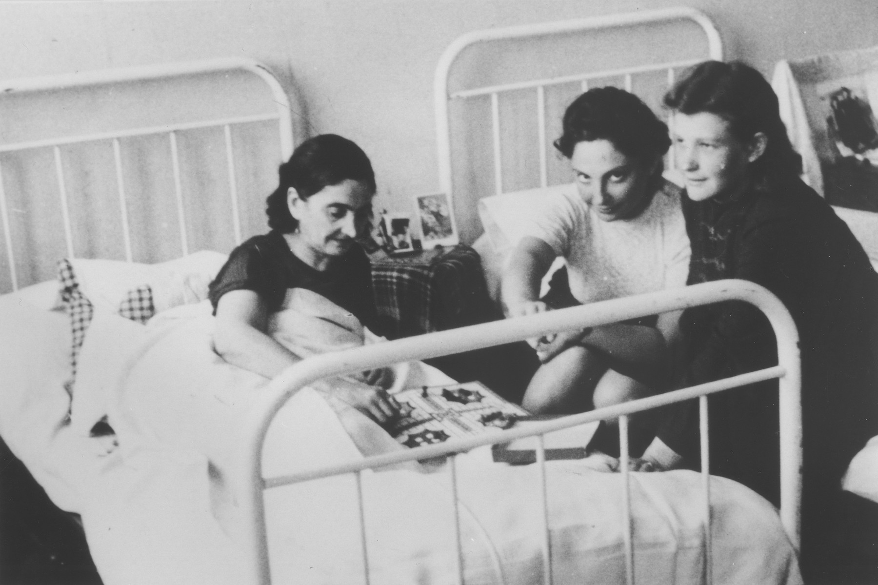Two Jewish DP women visit a friend in the Munich hospital.  Pictured on the left is Chenntze Gaviseza who was wounded twice in concentration camp.