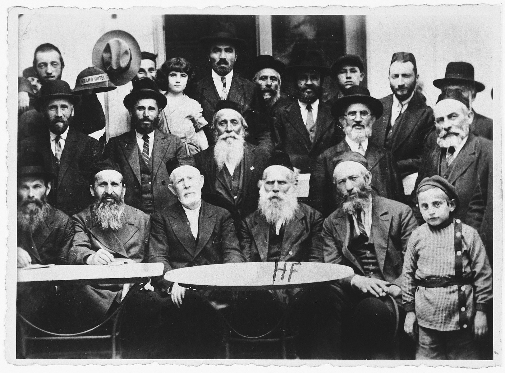 Group portrait of religious Jews at a gathering in Jaroslaw, Poland,  Among those pictured is Hersch Zvi Friedberg (front row, center), the father-in-law of Ida (Jam) Friedberg.