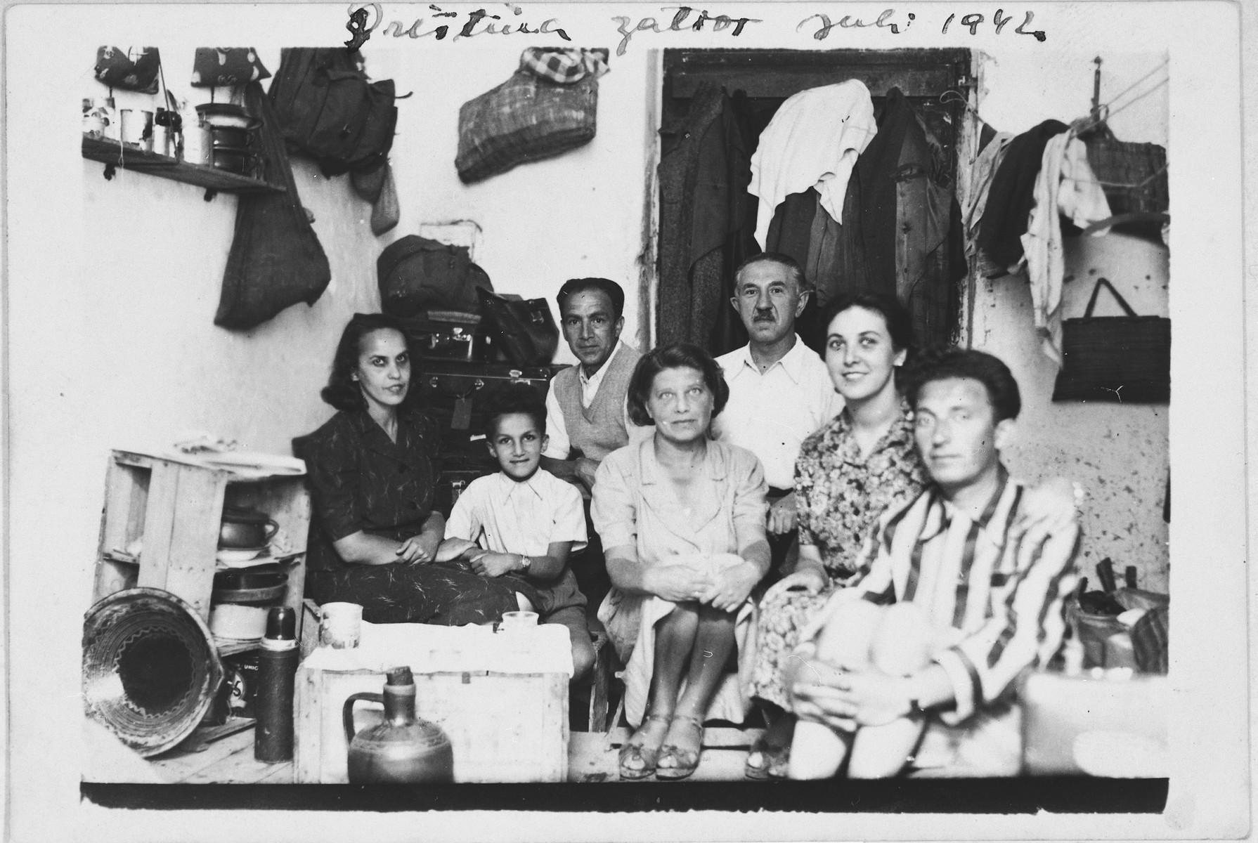Jewish refugees living in a prison cell in Italian-occupied Pristina.  Among those pictured are Majer and Mimi Altarac with their son Jasa (left side).