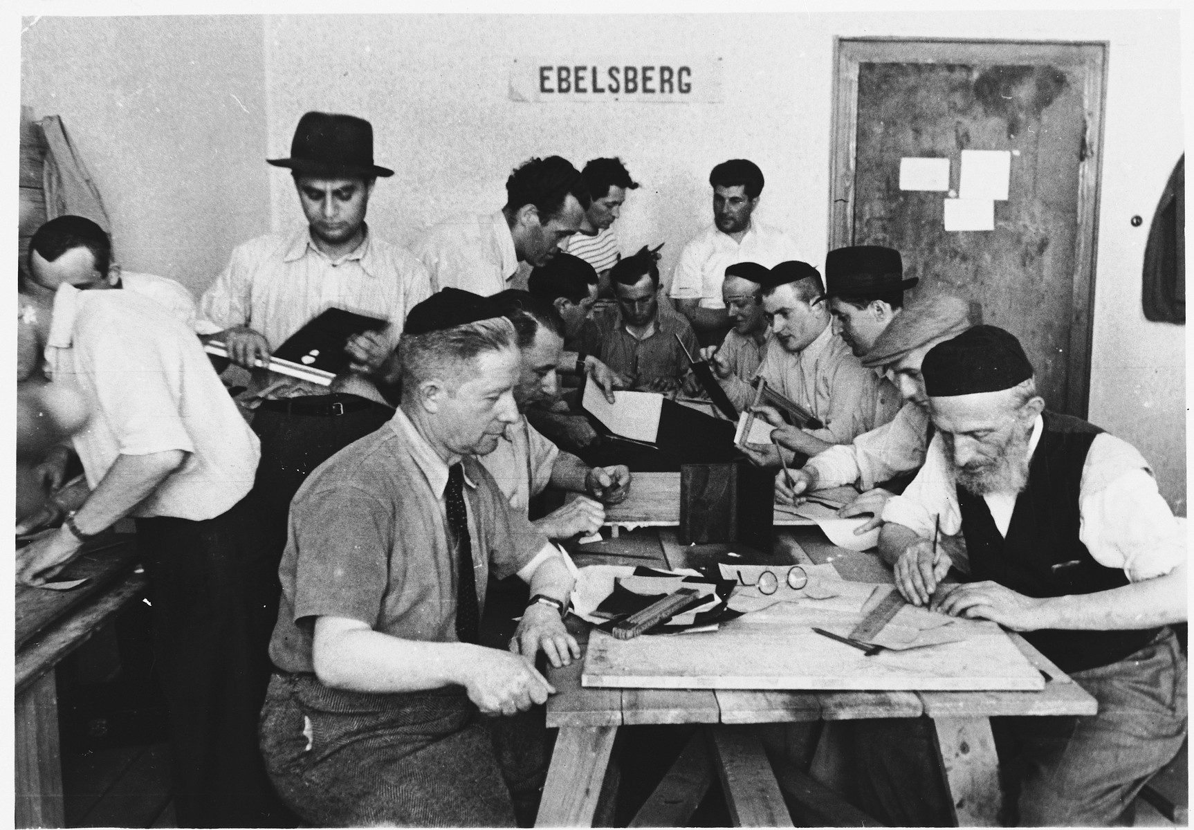 Religious Jews work in an ORT vocational workshop in the Ebelsberg displaced persons' camp.