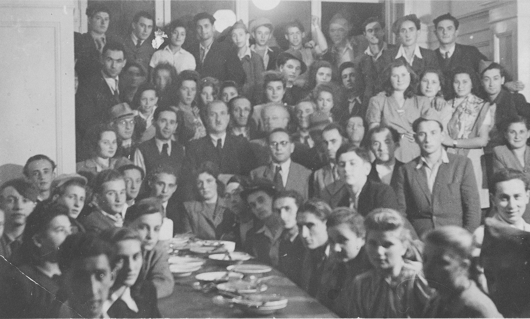 Jewish displaced persons and American Jewish soldiers attend a Yom Kippur break fast in Heidelberg.