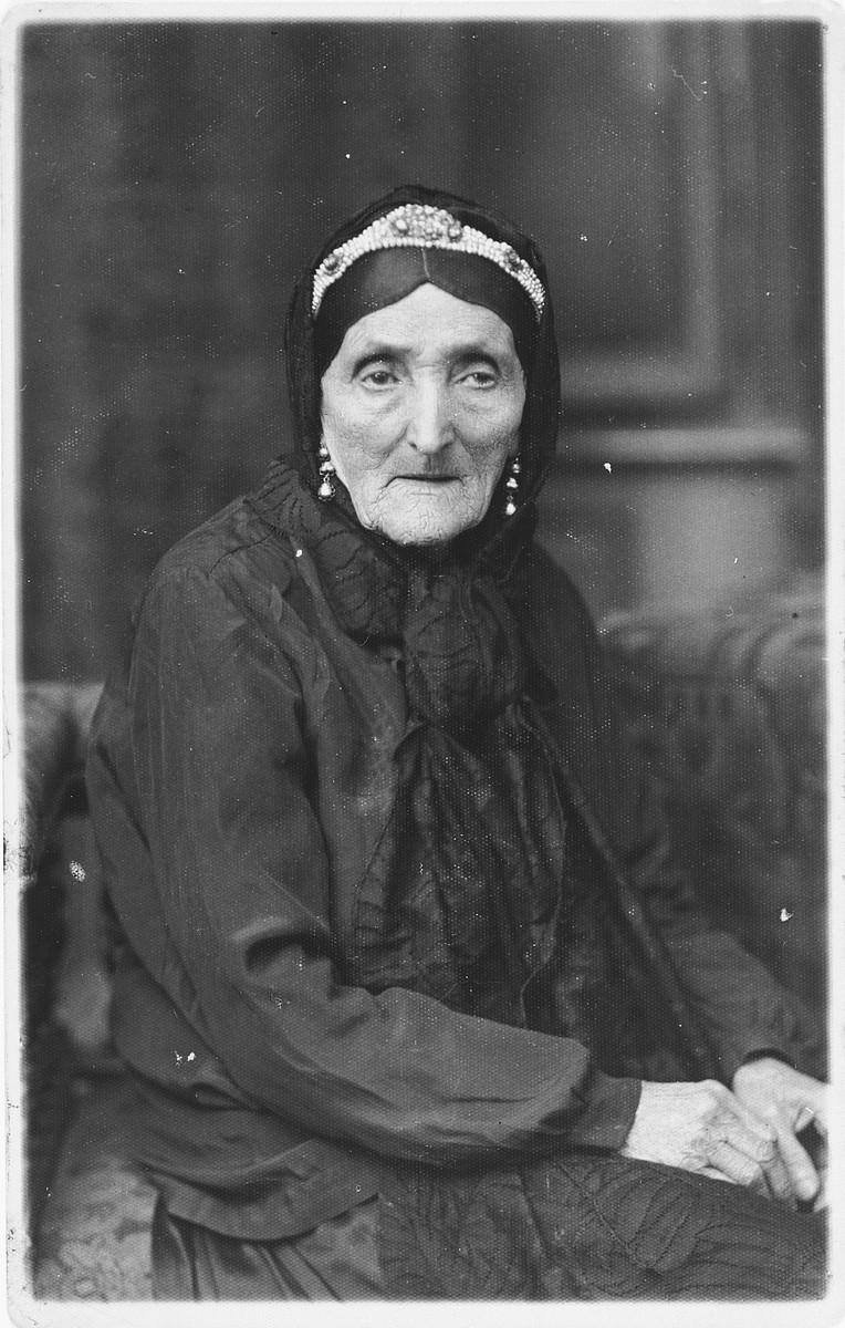 Studio portrait of an elderly Jewish woman in Rzeszow, Poland.  Pictured is Sprinza (Hammer) Jam, grandmother of Ida (Jam) Friedberg.