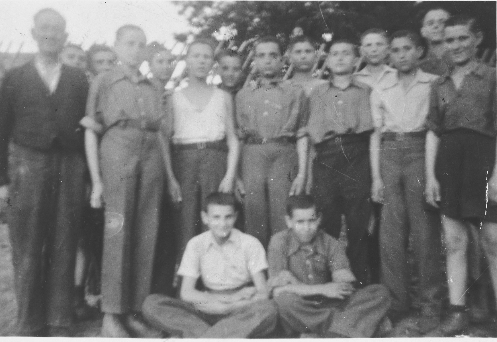 Group portrait of young teenage survivors of Buchenwald prior to their departure for children's homes in France and Switzerland.
