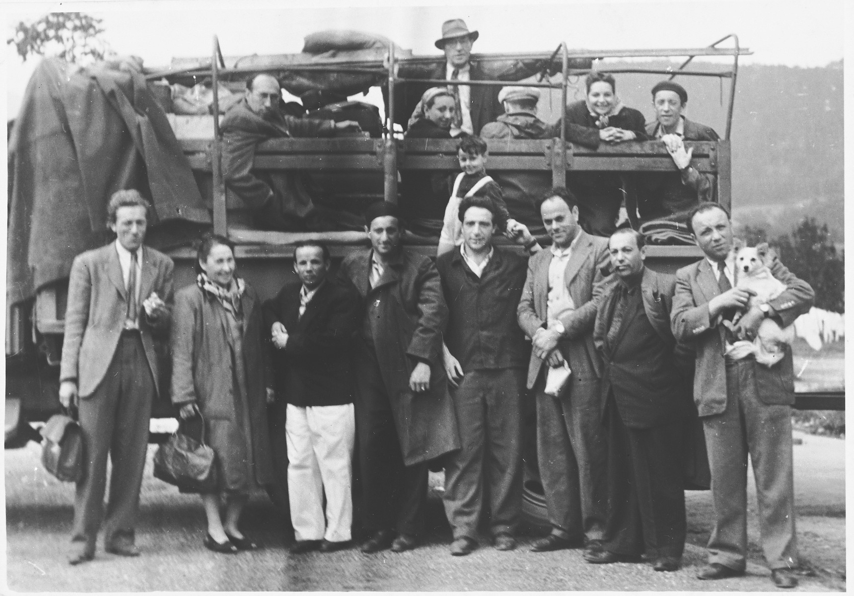 Jewish DPs gather in front of and inside an open truck in the Landsberg DP camp.