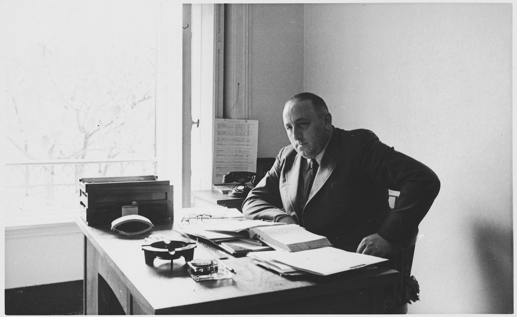 Albert Nussbaum, Comissioner of Emigration for Luxembourg and Director of Transmigration for the American Joint Distribution Committee, poses in his office in Lisbon.
