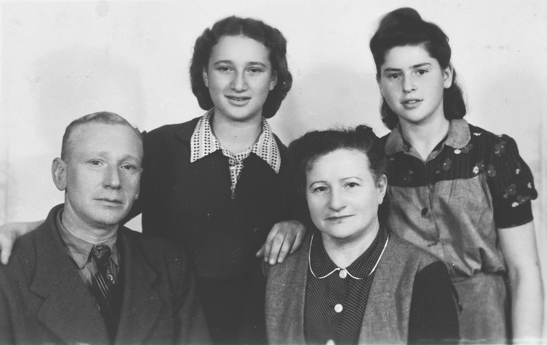 Portrait of Rivka Baran, her parents and friend, Nechama Santokski, in Lodz after liberation.