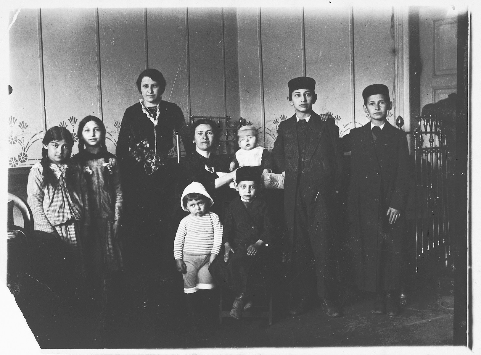 Tzivia Friedman poses in her home with seven of her ten children.  The entire family died from typhus before the war.