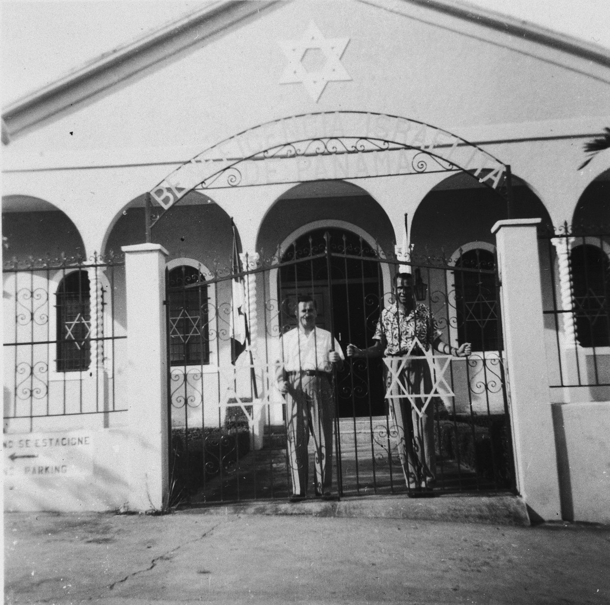 David Bayer, a Jewish DP immigrant from Poland, stands at the gate to a synagogue in Panama City.