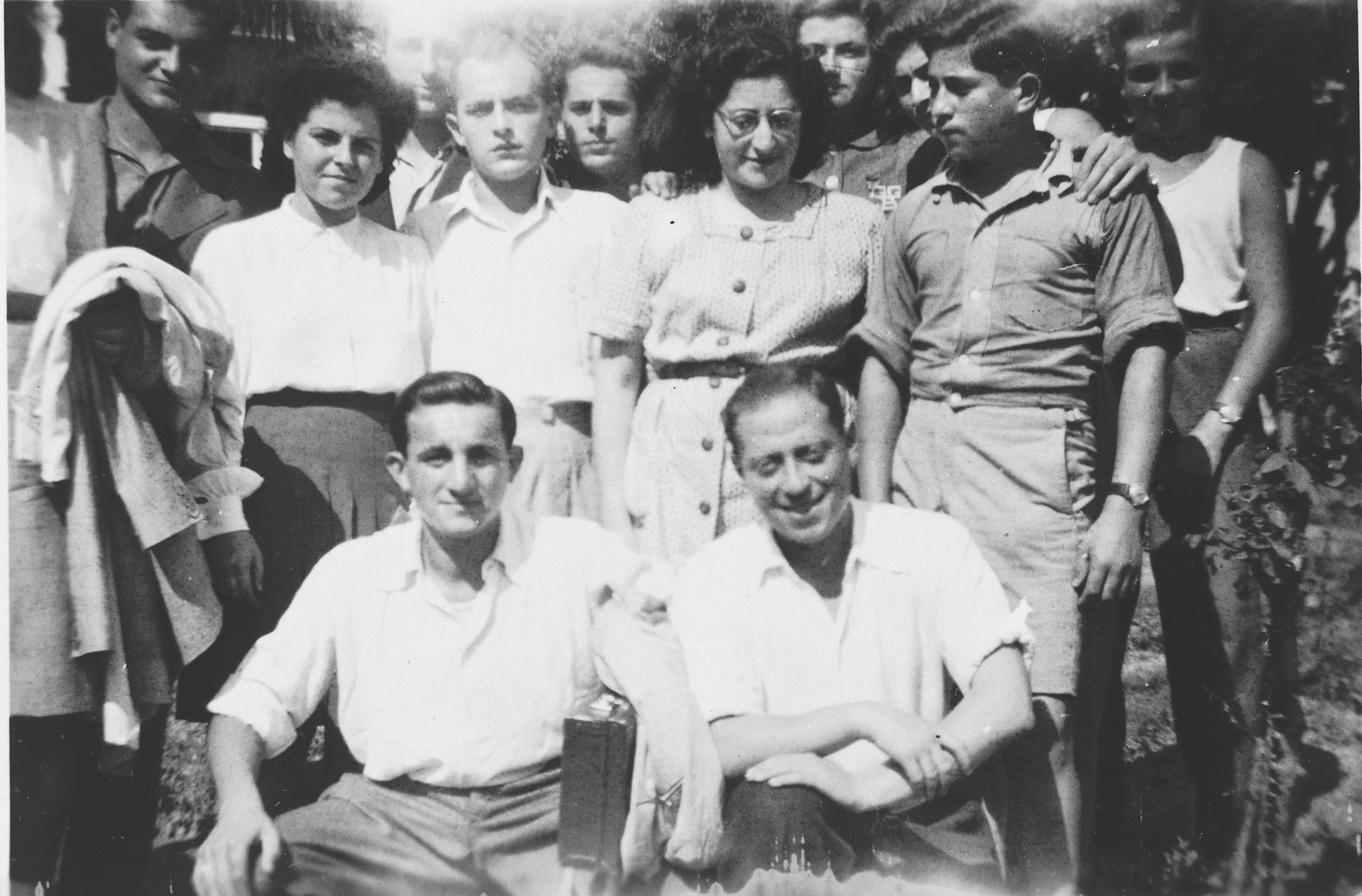 Group portrait of Jewish teenagers who came to Switzerland after their liberation from Buchenwald.  Among those pictured is Abraham Grajz (middle row, right).  Arthur Bornstein is standing in the back row on the far left. Stanley Appel is seated on the left.