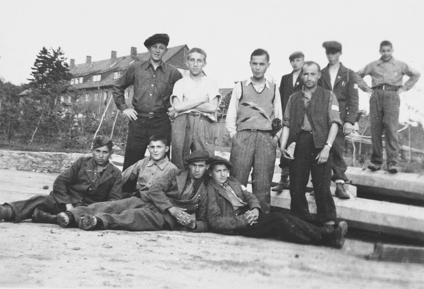 Group portrait of young teenage survivors of Buchenwald prior to their departure for children's homes in France and Switzerland.  Abraham Grajz is pictured on the bottom left.