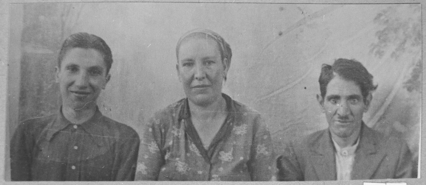 Portrait of Haim Aleshandra, his wife, Sara, and his son, David.  Haim was a Porter and David, a student.  They lived at Avramova 62 in Bitola.